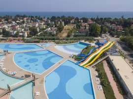 Просторные квартиры в Эрдемли, Мерсин с отельной инфраструктурой и аквапарком всего в 350 метрах до моря