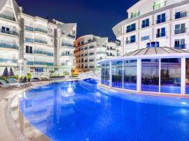 Комплекс апартаментов в Лимане, Коньяалты отельного типа люкс класса с большим бассейном и гарантией аренды - 586 | Tolerance Homes